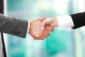 Handshake between business men